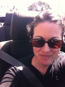 Here is me trying to get a glamour shot while riding in the convertible. Not possible.